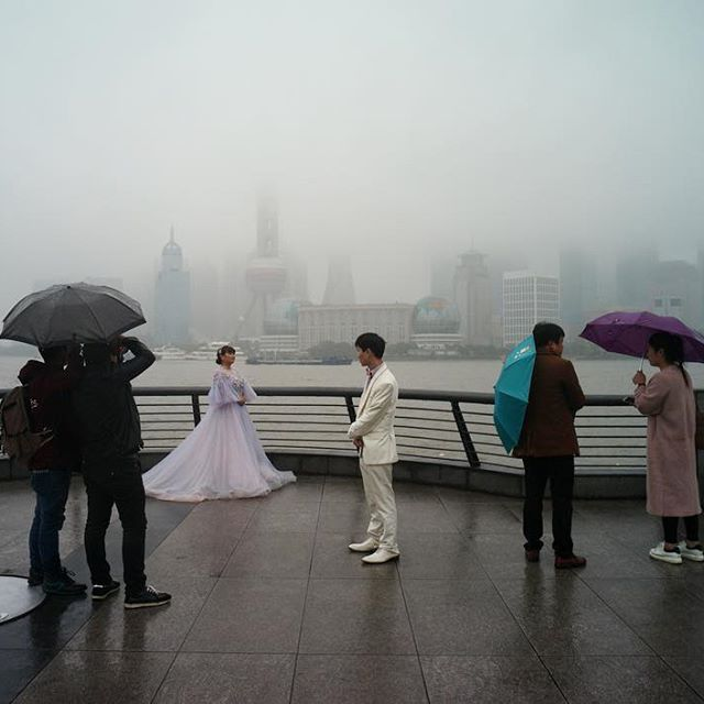 No matter the weather. #weddingphotography in #shanghai #china #thebund #leica #leicam9 #leicacamera #wedding